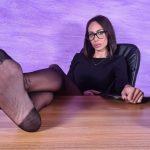 Sexy Daniela looks stunning putting her legs on the desk